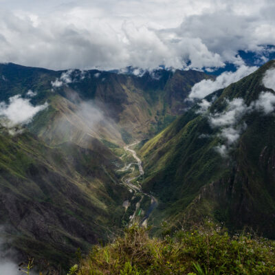 Panoramic view from the top of Machu Picchu mountain, the river and the Hidroelectrica, Peru