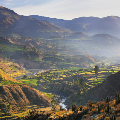 View of Colca Canyon with morning fog in Peru. It is one of the deepest canyons in the world with a depth of 3,270 meters.