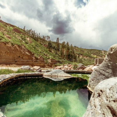 Pool of hot springs next to the rapids and mountains in the Colca Valley, Peru
