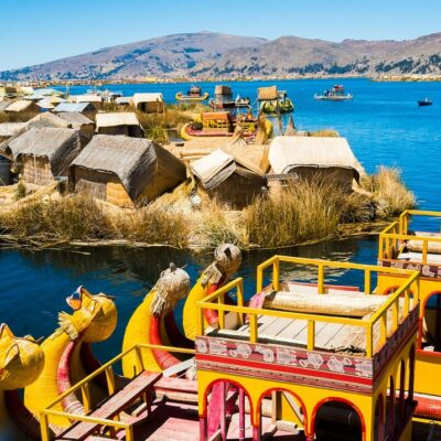 View of Uros floating islands with typical boats, Puno, Peru