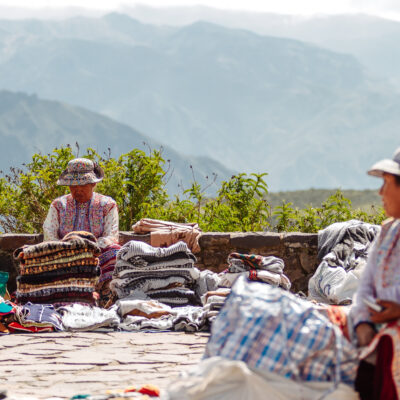 Arequipa, Peru - February 5, 2018: Two street vendor women offer souvenirs in the Colca Canyon, in the province of Arequipa