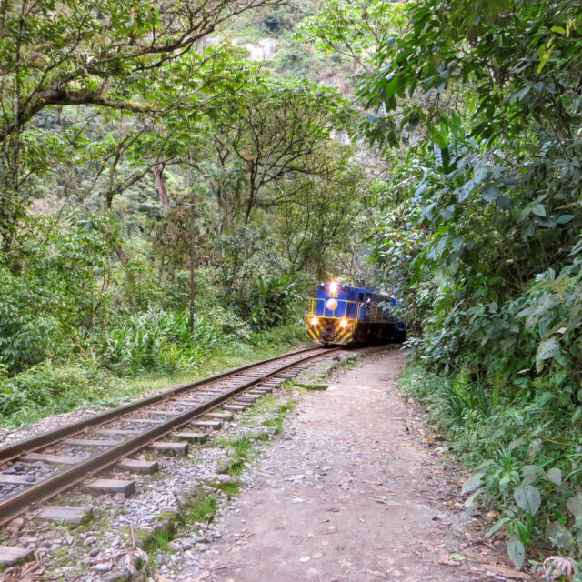 Hiking along the train tracks of Peru Rail on the road to Aguas Calientes and Machu Picchu
