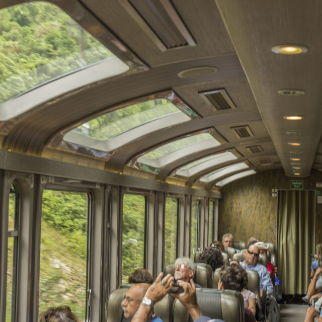 Tourist traveling in the panoramic Hiram Bingham train to Aguas Calientes in Perú. The town is the closest human settlement to the ancient Incan city of Machu Picchu and has become a tourist hub for visitors wishing to visit the famous Incan city.