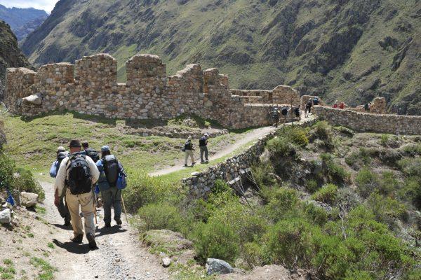 Cusco, Peru - November 14, 2010: Several hikers on the classic Inca Trail in Peru head toward the Incan ruins of Willkarakay.