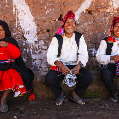 "Taquile is an island on the Peruvian side of Lake Titicaca 45 km offshore from the city of Puno. About 1,700 people live on the island, which is 5.5 by 1.6 km in size (maximum measurements), with an area of 5.72 km2. The highest point of the island is 4050 meters above sea level and the main village is at 3950 m. The inhabitants, known as Taquilenos, are southern Quechua speakers. Taquilenos run their society based on community collectivism  and on the Inca moral code ama sua, ama llulla, ama qhilla, (Quechua for ""do not steal, do not lie, do not be lazy""). The island is divided into six sectors or suyus  for crop rotation purposes. The economy is based on fishing, terraced farming horticulture  based on potato  cultivation, and tourist-generated income from the approximately 40,000 tourists  who visit each year.Taquilenos are known for their fine handwoven textiles and clothing, which are regarded as among the highest-quality handicrafts in Peru. Everyone on the island - children, women, and men - spins and weaves.http://bem.2be.pl/IS/peru_380.jpg"